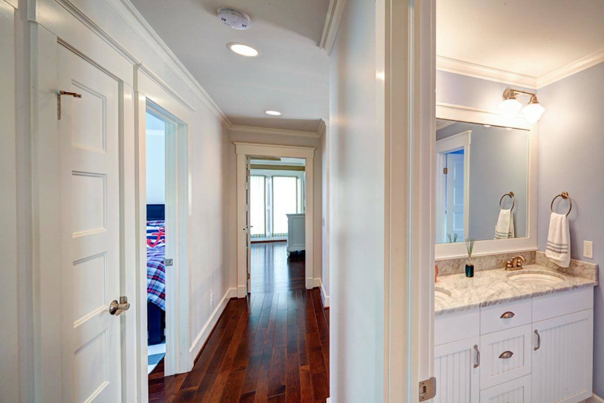 A second-floor hallway leading to the bathroom and bedrooms.
