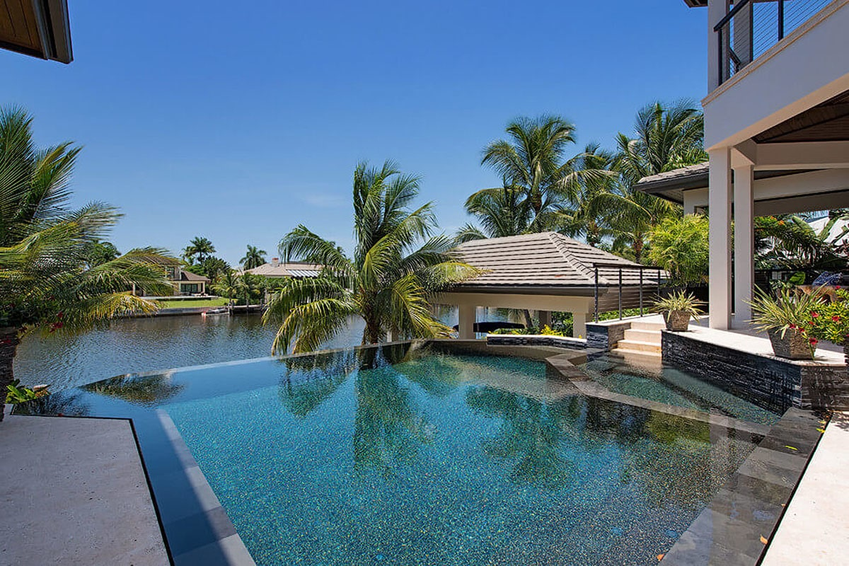 Stunning pool incorporated with a built-in spa and a covered lanai.