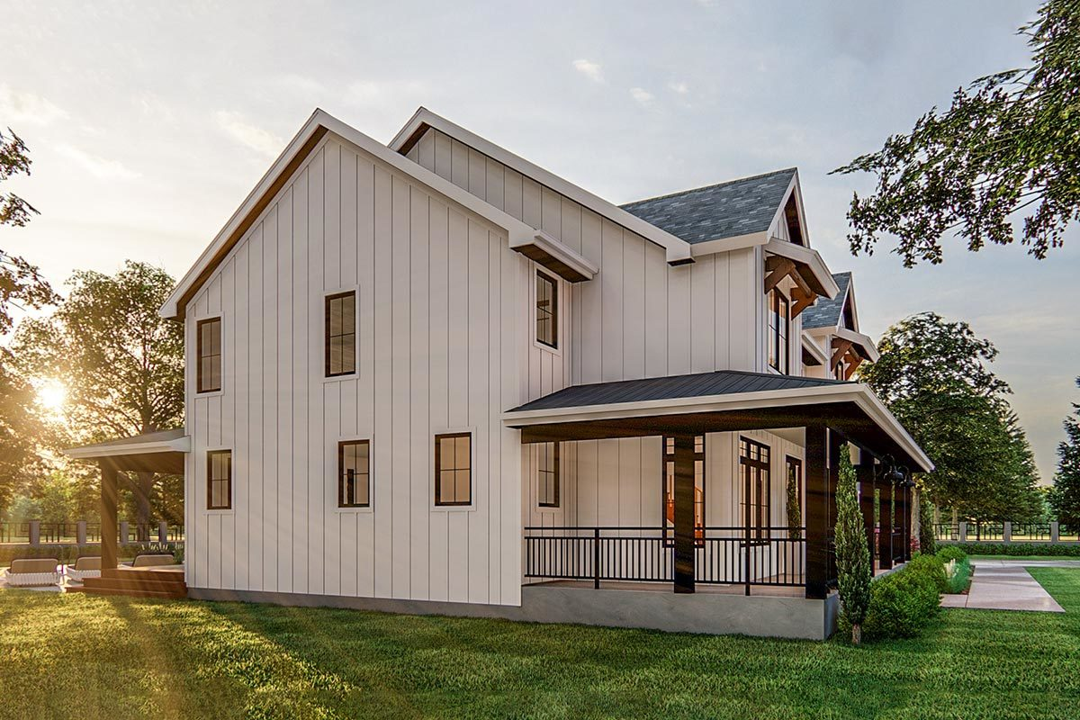 Left side view showing the vertical siding and a wrap-around porch framed with iron railings and rustic columns.