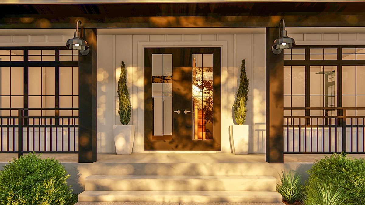 Home entry with a concrete stoop and a french front door flanked by white potted plants.