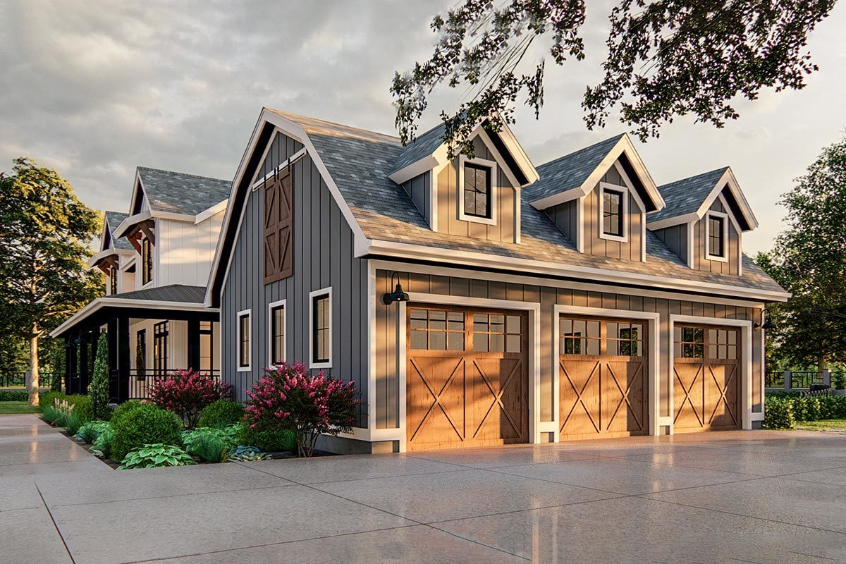 Right side view showcasing a three-car garage with barn doors and large dormers.