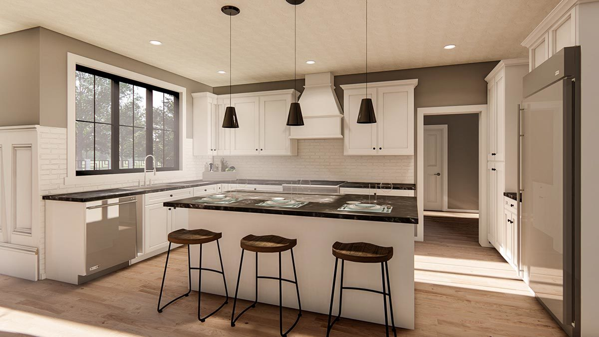 The kitchen is equipped with slate appliances, black granite countertops, white cabinetry, and a breakfast island.