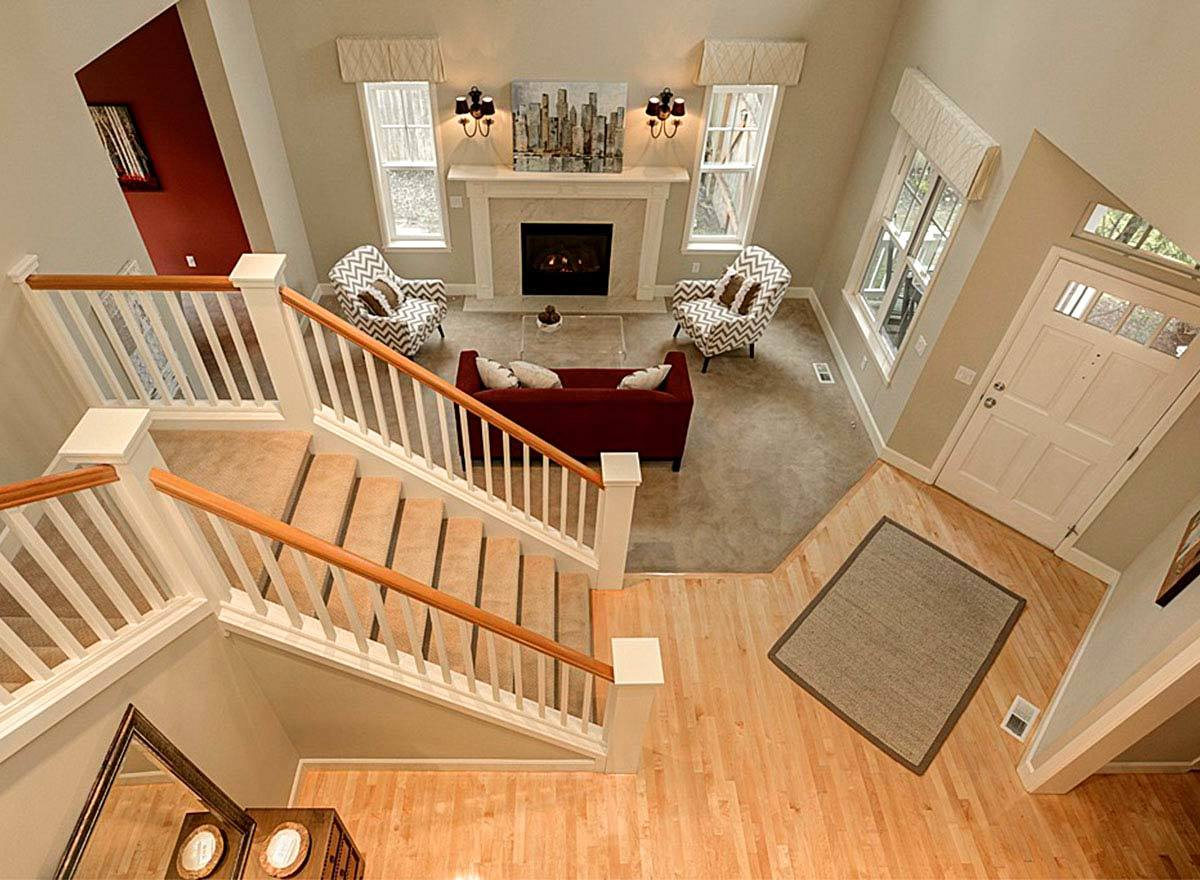 Top view of the foyer, staircase, and living room.