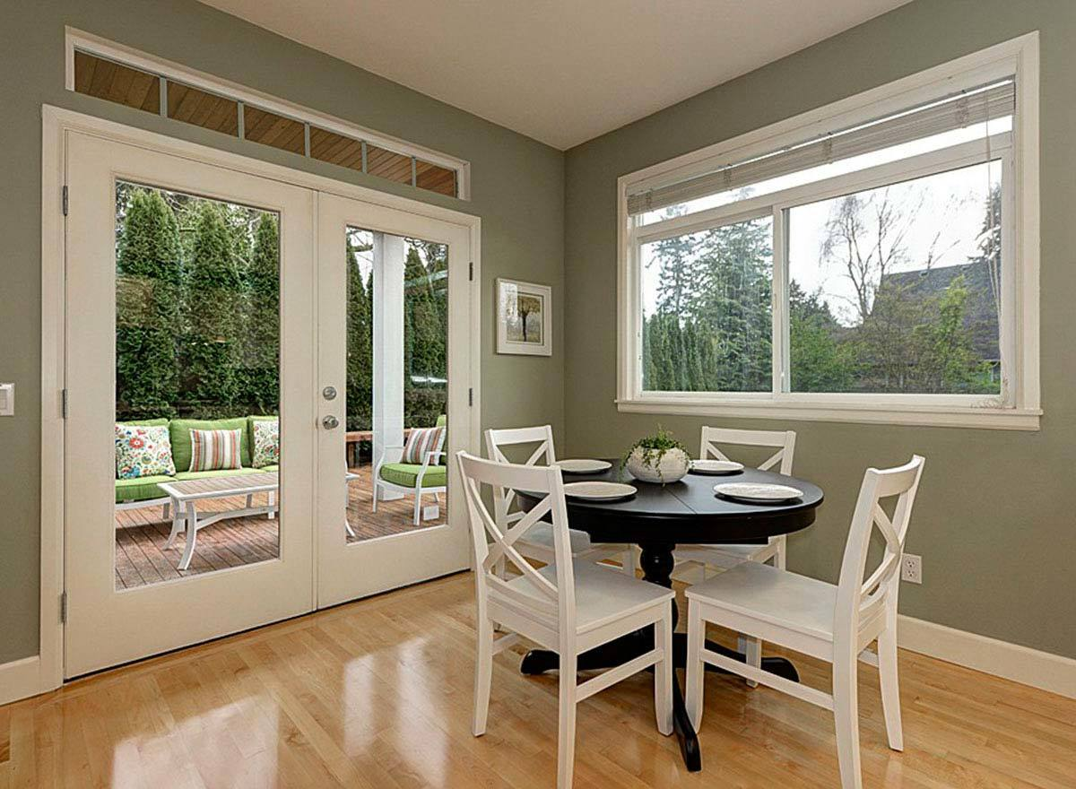 A french door on the left side opens to the covered patio.
