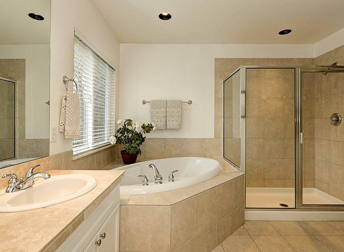 The primary bathroom is equipped with a walk-in shower, a drop-in bathtub, and a sink vanity.