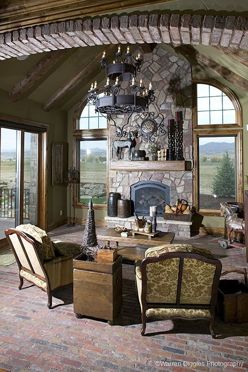 An abundance of natural light flows in from the glass windows and doors of the living room.