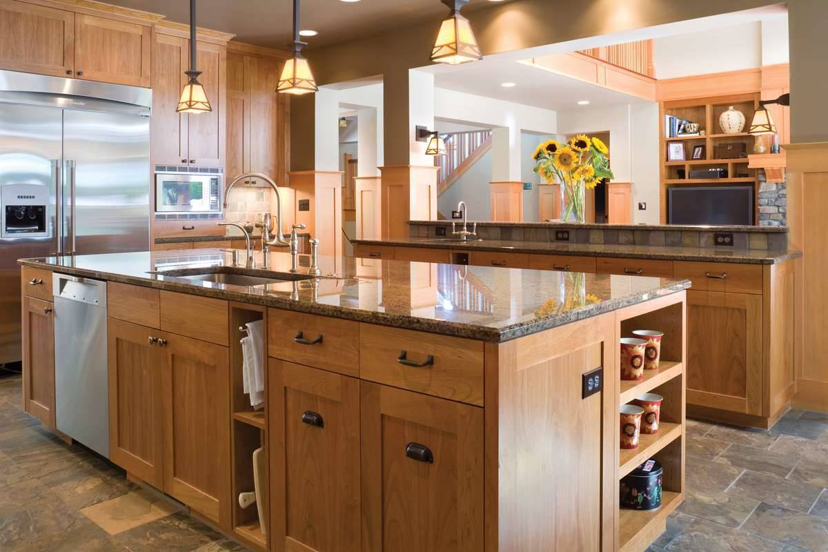 The center island is fitted with an undermount sink, slate dishwasher, and chrome fixtures.
