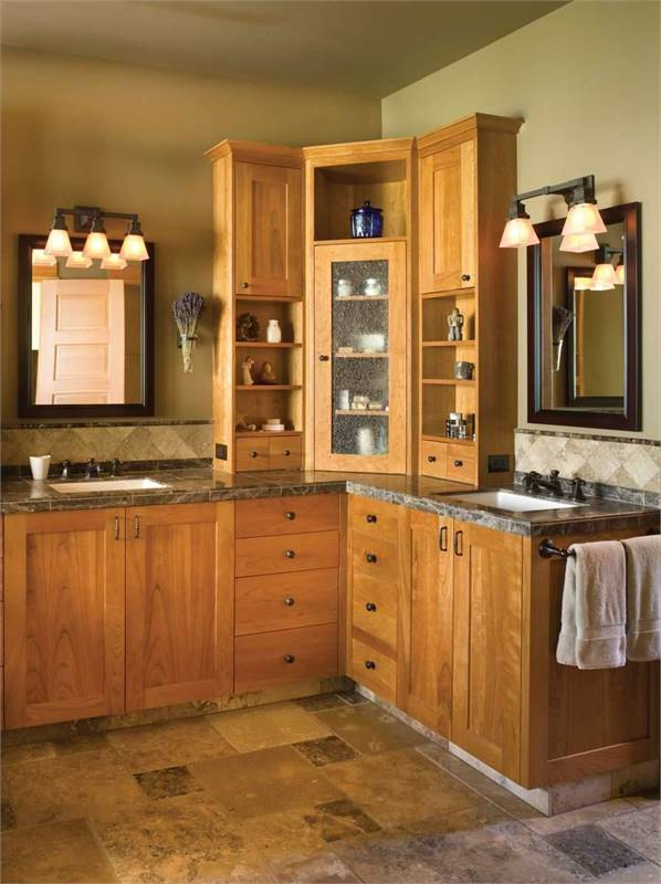 The primary bathroom has dual sink vanity paired with dark wooden framed windows.