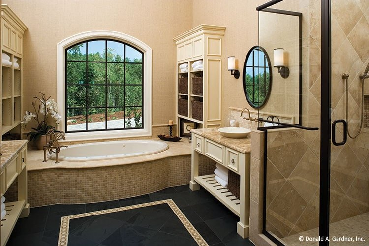 The primary bathroom is equipped with a shower, two vessel sink vanities, and a deep soaking tub.