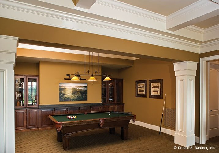 The billiards area is defined by decorative interior columns and wood-paneled lower wall.