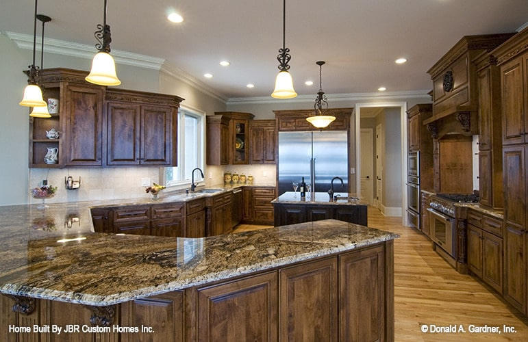 Glass pendants and recessed ceiling lights brighten the kitchen.