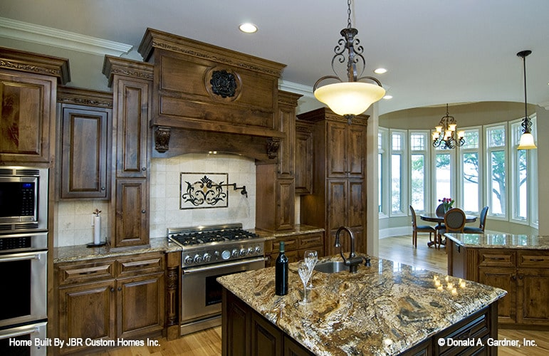 A breakfast nook on the right end provides natural light to the kitchen.