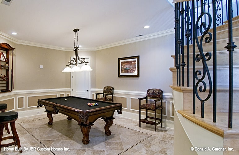 Entertainment area with cushioned seats and a billiard table under the glass dome pendants.