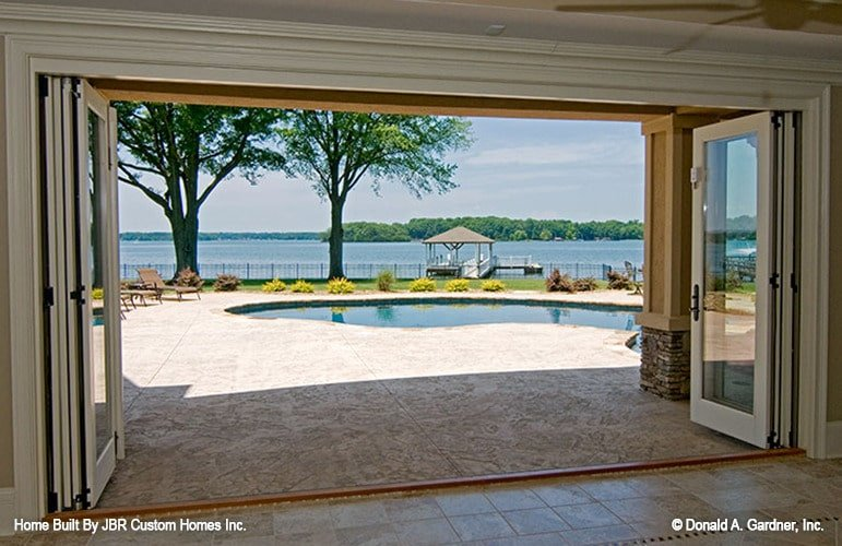 Folding glass doors open to the lanai and onto the private dock.