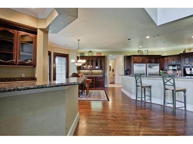 View of the spacious kitchen along with the breakfast nook situated near the bay window.