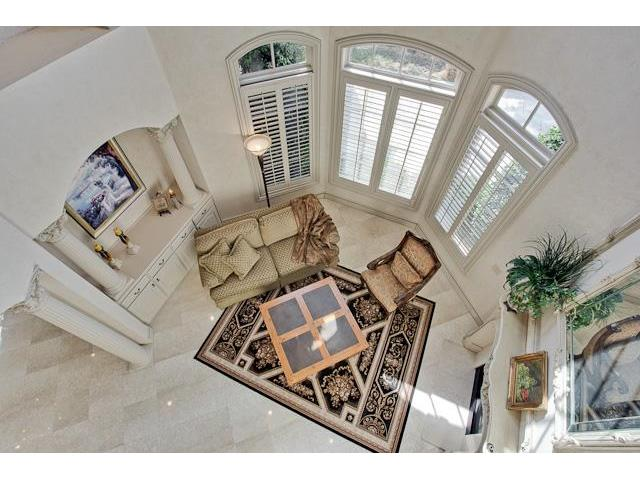 Top view of the living room showing its arched bay window and limestone flooring.