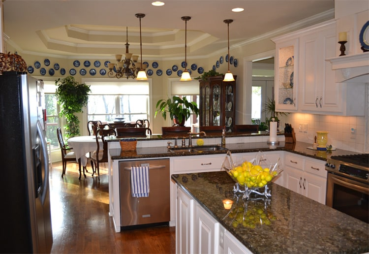 Across the kitchen is the dining area crowned with a stunning step ceiling.
