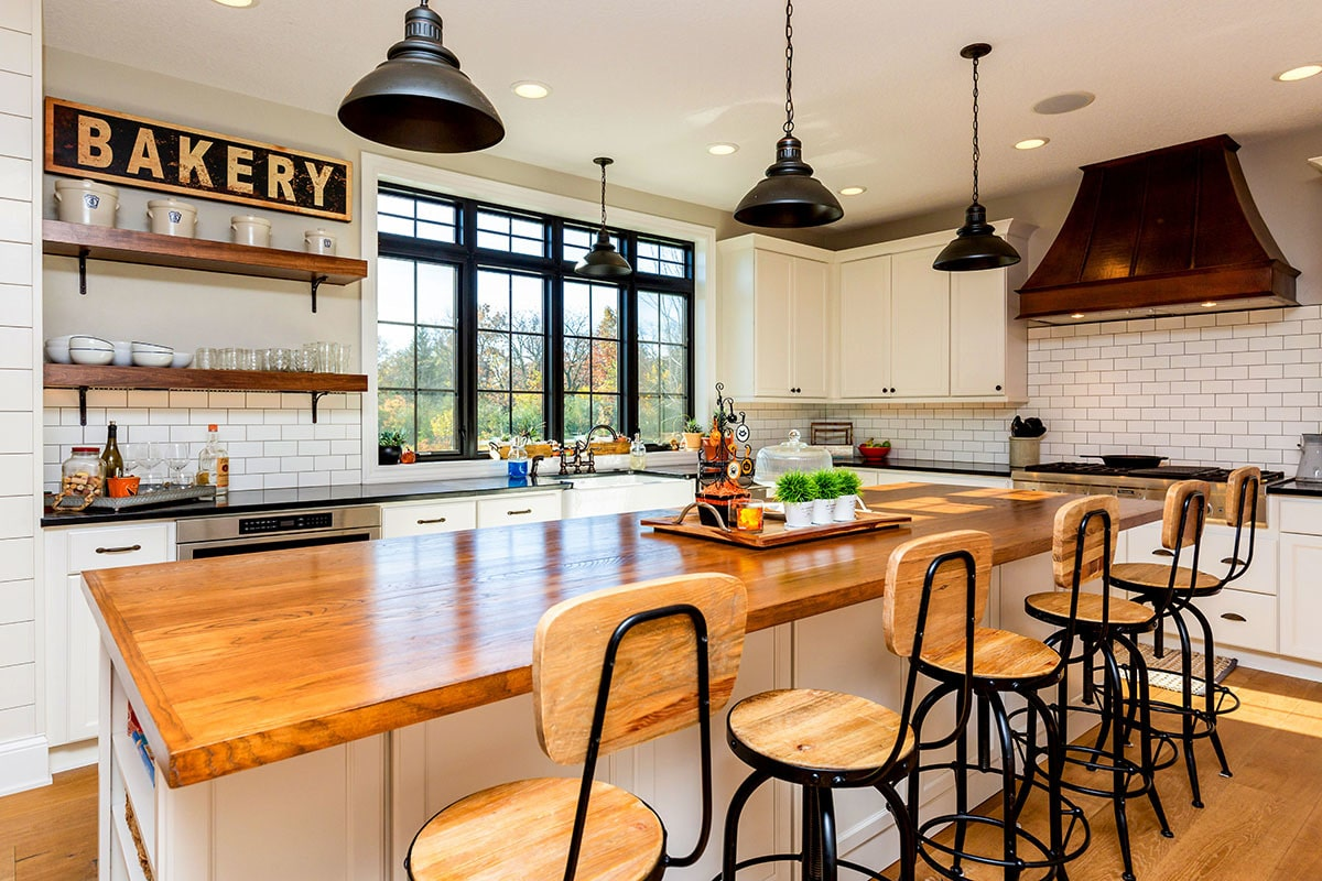 Round bar stools along with dome pendant lights complement the breakfast island.
