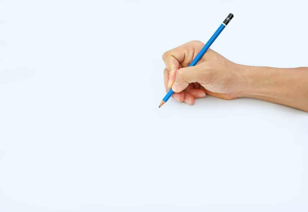A hand holding a 5B pencil.