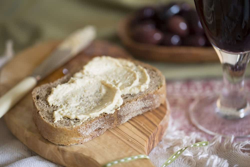 Toast bread with spread on a wooden board.