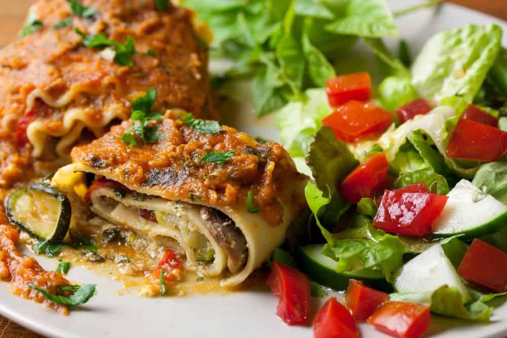 Vegan lasagna with salad on the side.