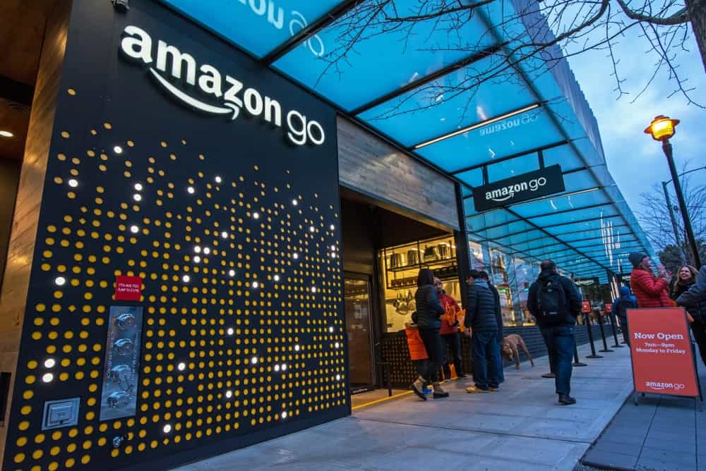 Amazon Go store with glass, perforated metal, and wood exterior.
