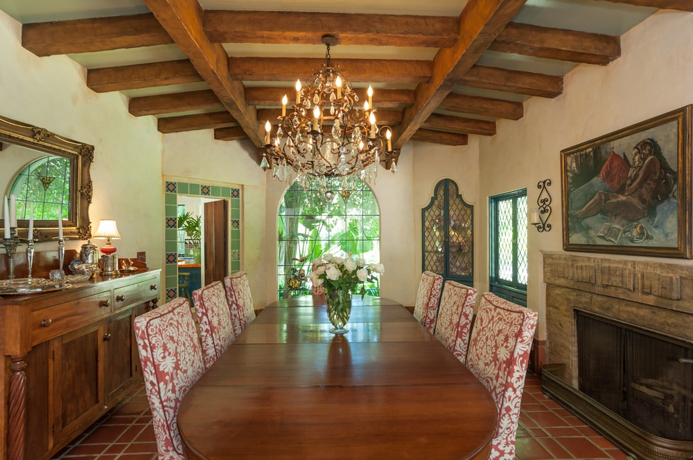 The formal dining room has a large wooden dining table surrounded by upholstered chairs and beige walls. Image courtesy of Toptenrealestatedeals.com.
