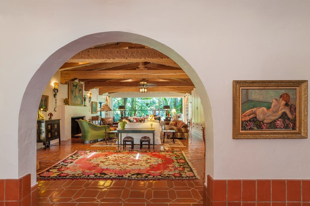 This side of the foyer has a large arched entryway that leads to the living room. Image courtesy of Toptenrealestatedeals.com.
