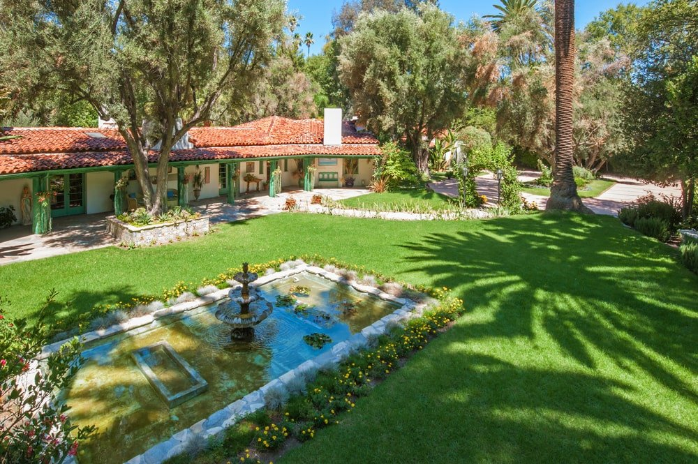 This is an aerial look at the lily pond with a fountain the middle and surrounded by a grass lawn. Image courtesy of Toptenrealestatedeals.com.