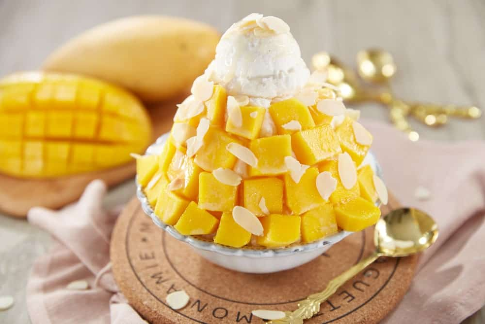 Mango-flavored bingsu in a bowl.