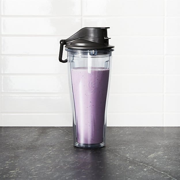 Vitamix blender to-go-cup on a gray countertop.