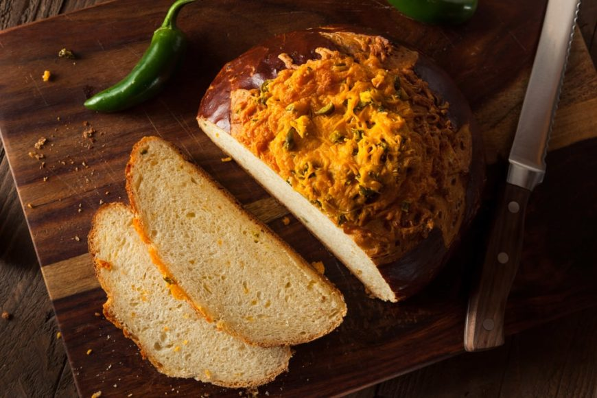 A look at a sliced loaf of cheddar jalapeno bread.