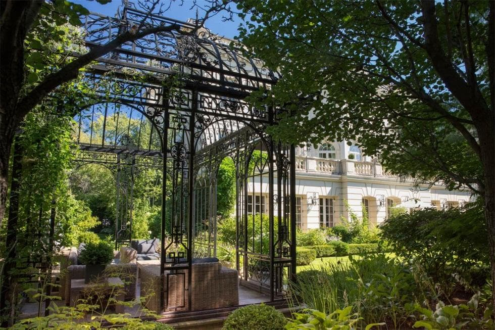 This is the vintage gazebo at the garden made of wrought-iron. This pairs well with the outdoor sofa set and the surrounding landscape. Image courtesy of Toptenrealestatedeals.com.