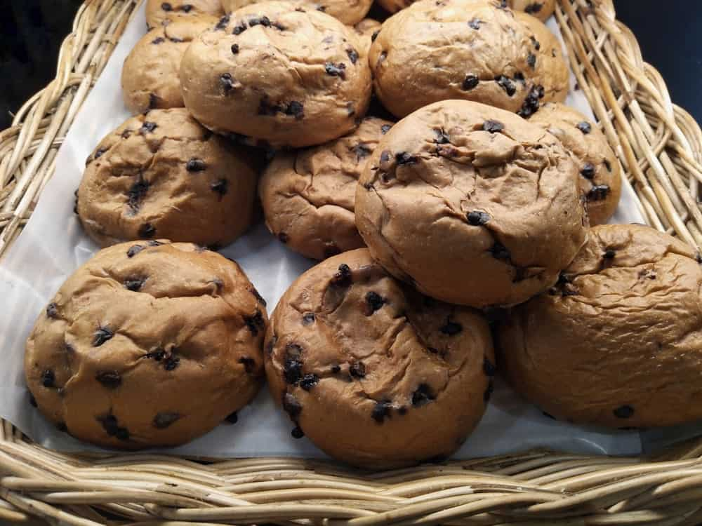 Chocolate chip cookies in a wicker tray.
