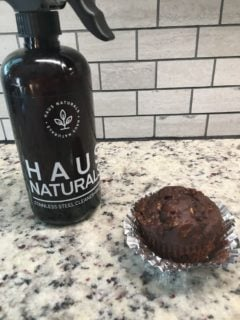 A piece of freshly-baked chocolate zucchini muffin.