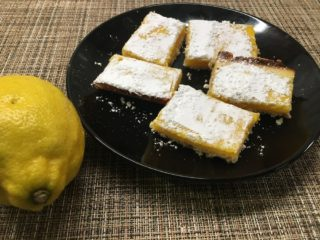 This is a look at a plate of freshly-baked lemon bars.