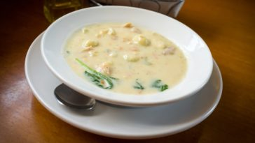A bowl of creamy chicken and gnocchi soup.