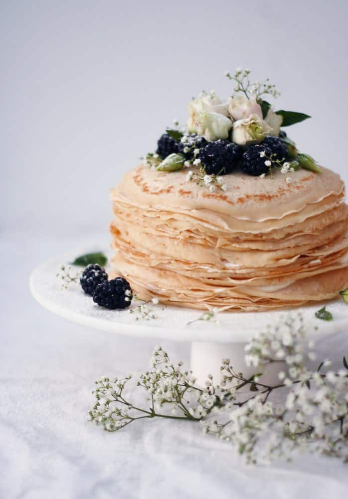 Crepes cake topped with blueberries.
