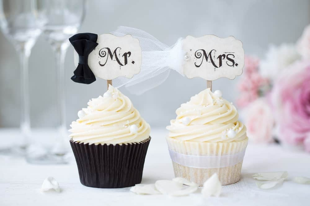 Mr. and Mrs. cupcakes on a wedding table.