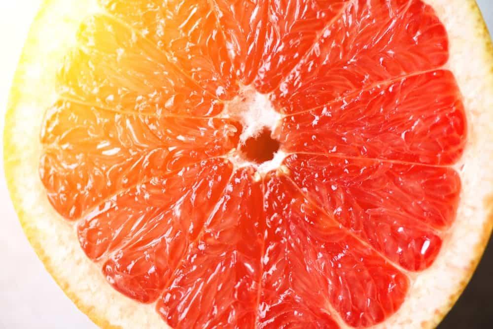 Closeup of a slice of grapefruit.