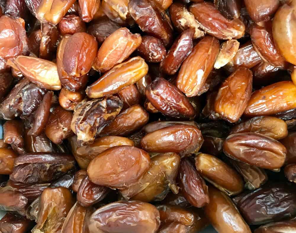 A pile of Deglet Noor dates.