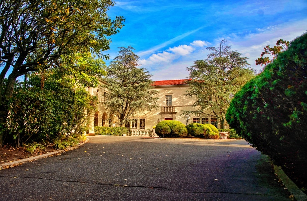 After entering the gate, this driveway leads you to the large courtyard in front of the house. Image courtesy of Toptenrealestatedeals.com.