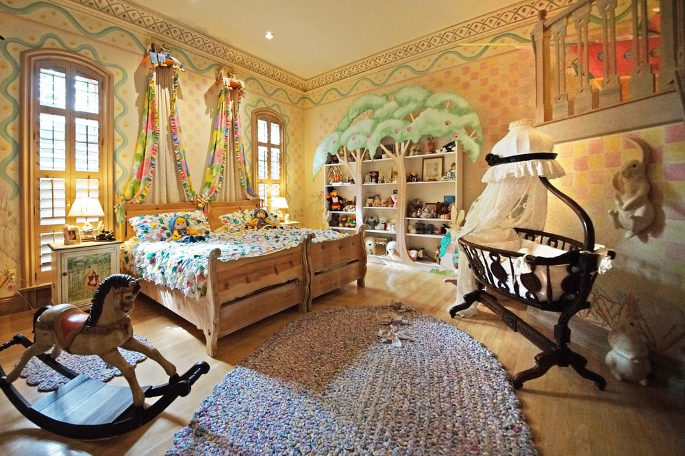 This is the nursery and children's bedroom that has colorful walls, sheets and curtains. Image courtesy of Toptenrealestatedeals.com.
