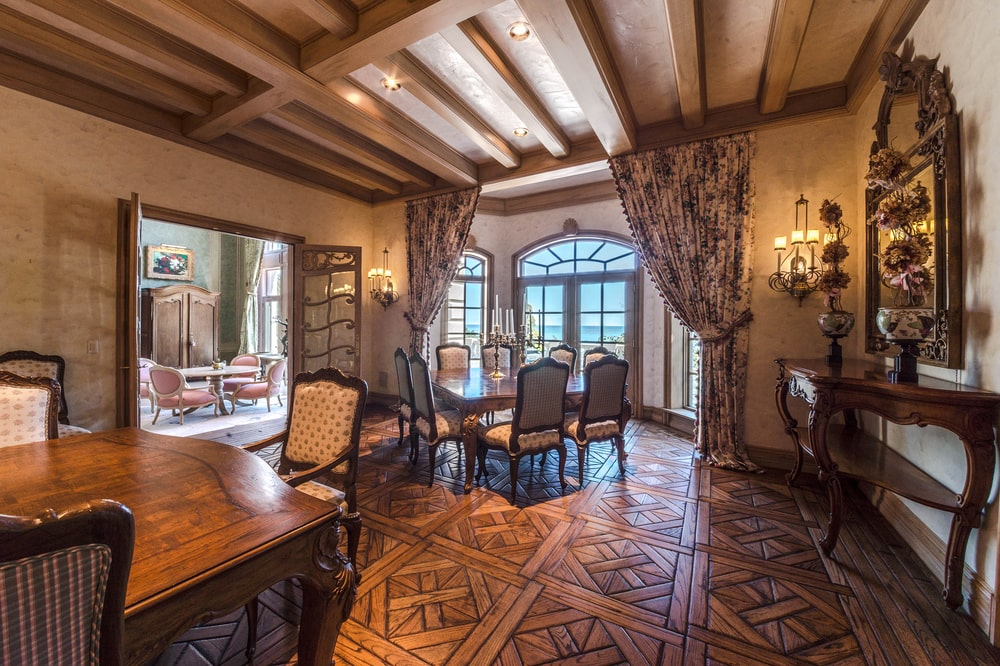 The formal dining area also has a separate dining table at the far end for the kids. Image courtesy of Toptenrealestatedeals.com.