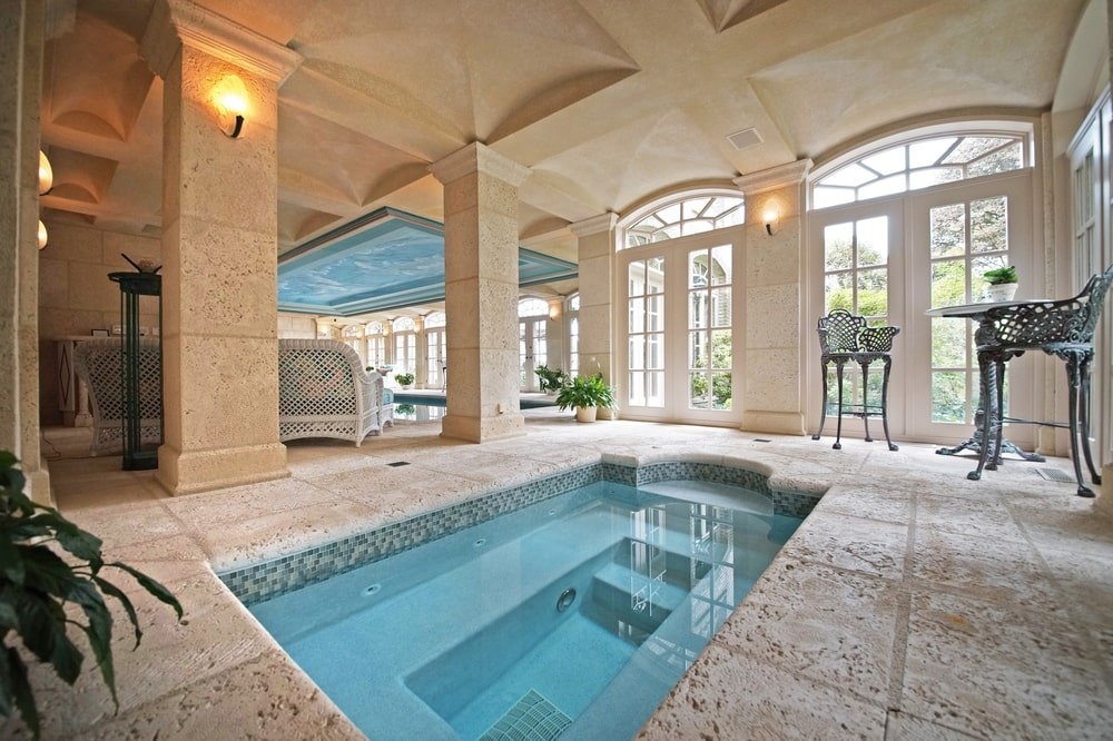 This is the indoor spa that is a few steps from the pool. This area has beige walls, columns and ceiling. Image courtesy of Toptenrealestatedeals.com.