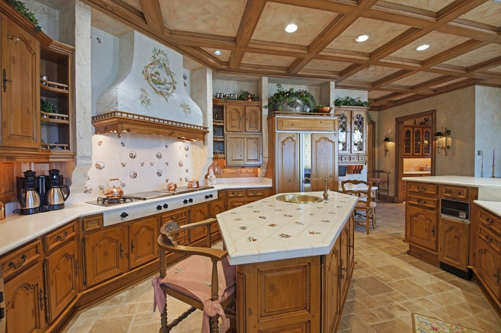 This is the kitchen that has a large kitchen island topped with a coffered ceiling that matches the cabinetry. Image courtesy of Toptenrealestatedeals.com.