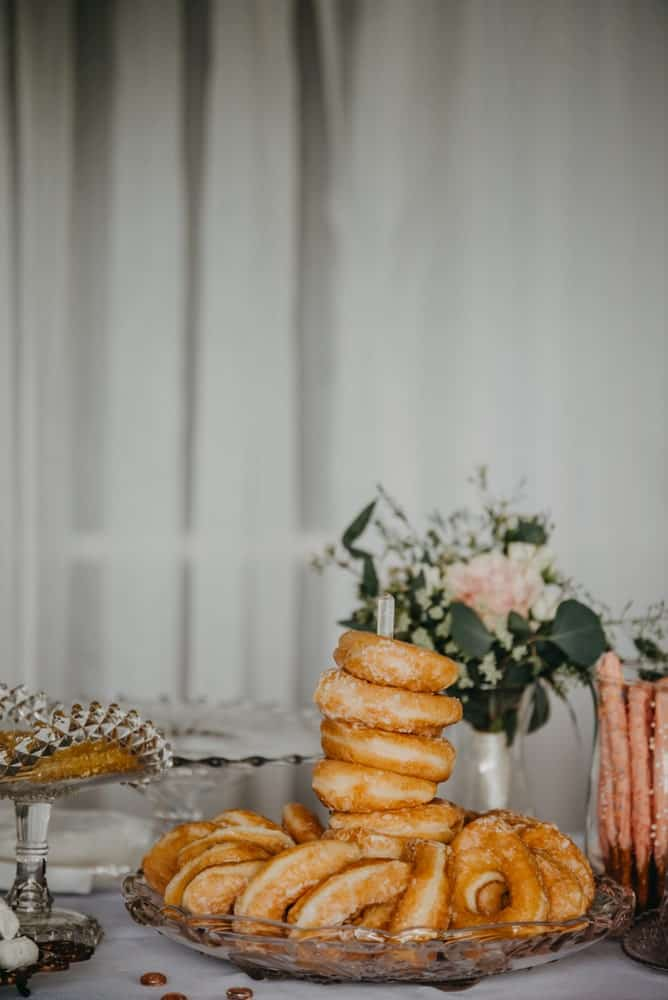 A plate of donuts on a wedding reception.