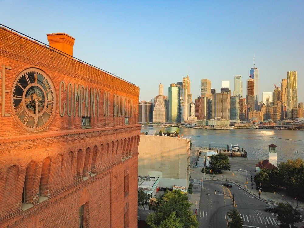 This is the exterio aerial look at the clock face of the loft with vintage signage of the Eagle Company. Image courtesy of Toptenrealestatedeals.com.