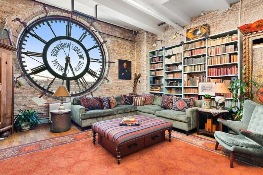 This is a look at the great room that houses the dining area, living room area and a mini library. These are all complemented by the large clock face that also acts as a large glass window. Image courtesy of Toptenrealestatedeals.com.