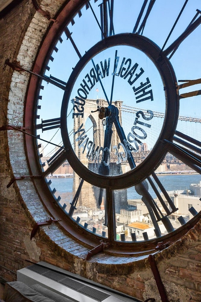 This is a closer look at the clock face of the great room. It also acts as a large glass window that brings in natural lighting and views of the river and skyline. Image courtesy of Toptenrealestatedeals.com.